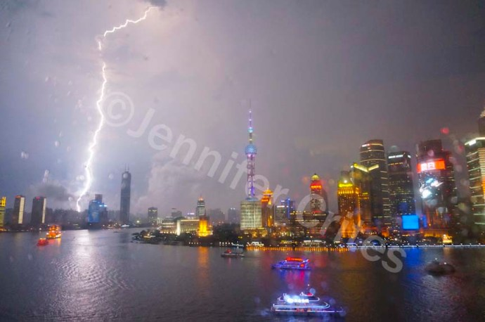 Lightening splits the sky over Pudong during a brief evening rain storm.