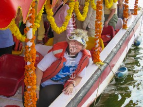 the author and photographer in a marigold bedecked boat on Lake Pichola